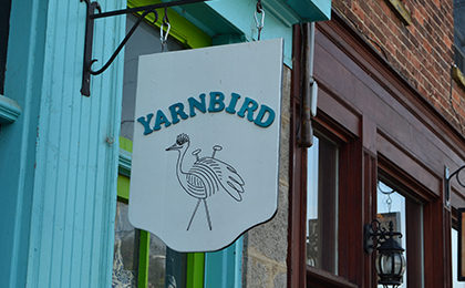 Yarnbird store front sign