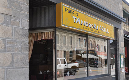Store front with yellow sign that reads Fergus Tandoori Grill, Fine Indian Cuisine