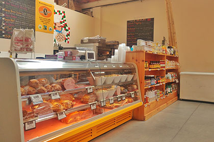 An interior image of Fraberts Fresh Food's deli counter inside the store that is located in the historic Fergus Marketplace in downtown Fergus.