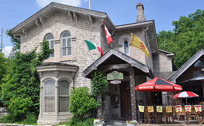 Historic building that features an Inn with two restaurants, each with an outoor patio in downtown Fergus.