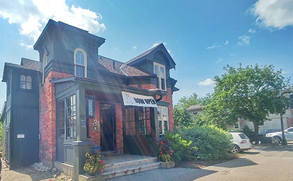 An indoor cafe with an outdoor garden patio set in a former historic home in downtown Fergus.