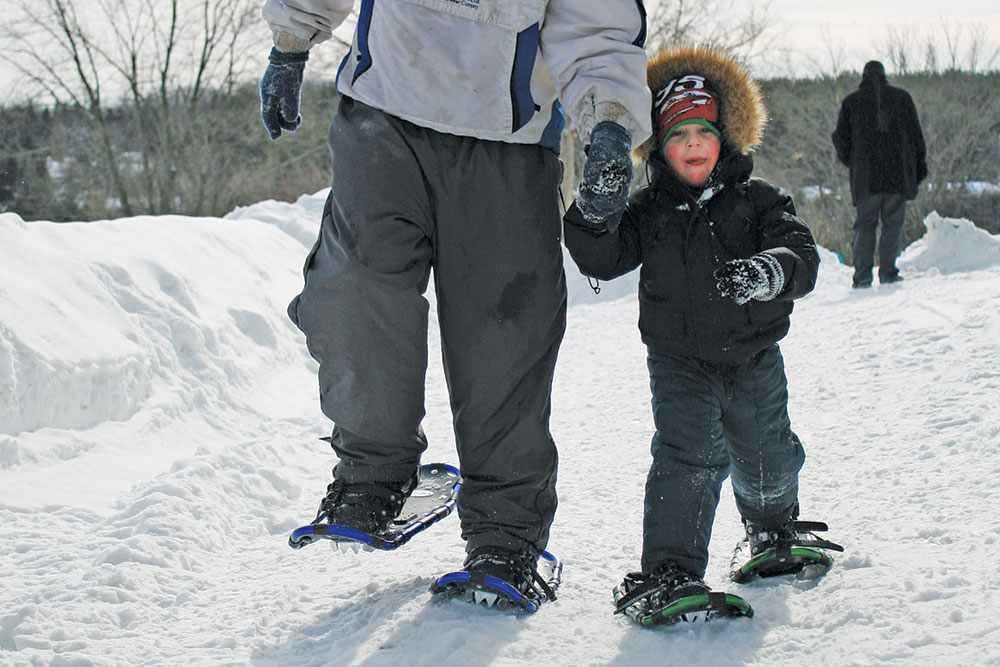 Father and Son snow shoeing the trails in Elora-Fergus